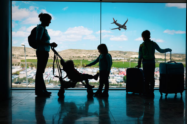 Family with kids at airport traveling