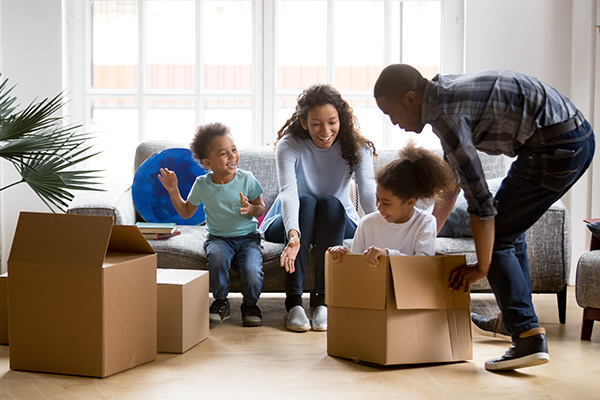 Family with children playing during a move