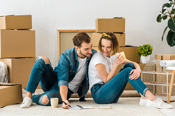 Couple doing work during a move