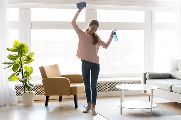 Woman cleans her living room.