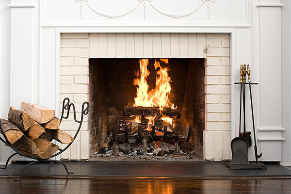 A nice fire going in a home fireplace.