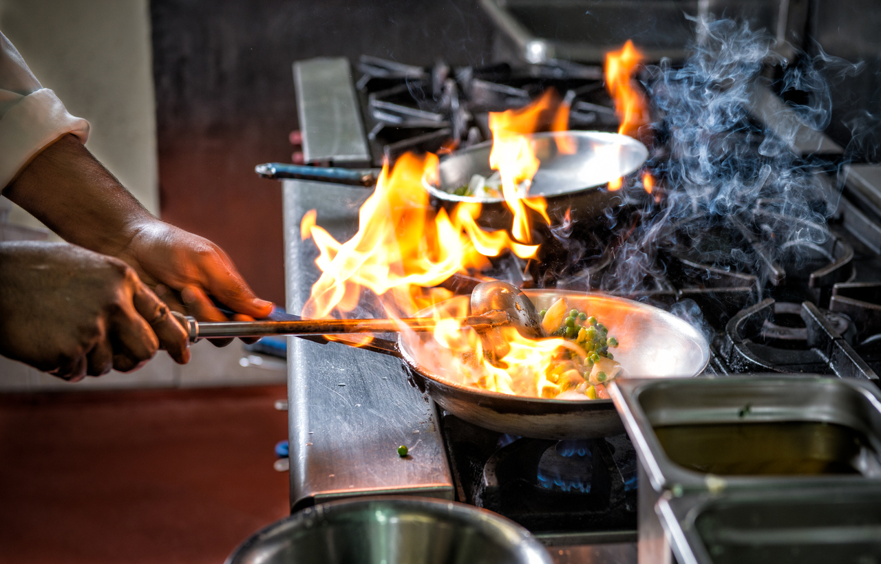 preparing food in flaming pan