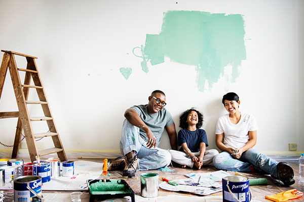 A family takes a break from painting their house