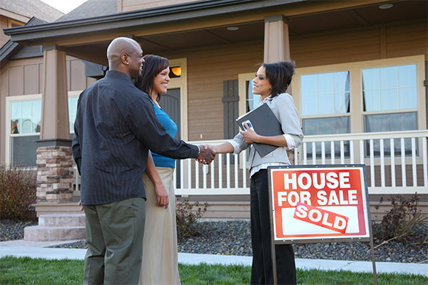 A couple buys a home with a real estate agent